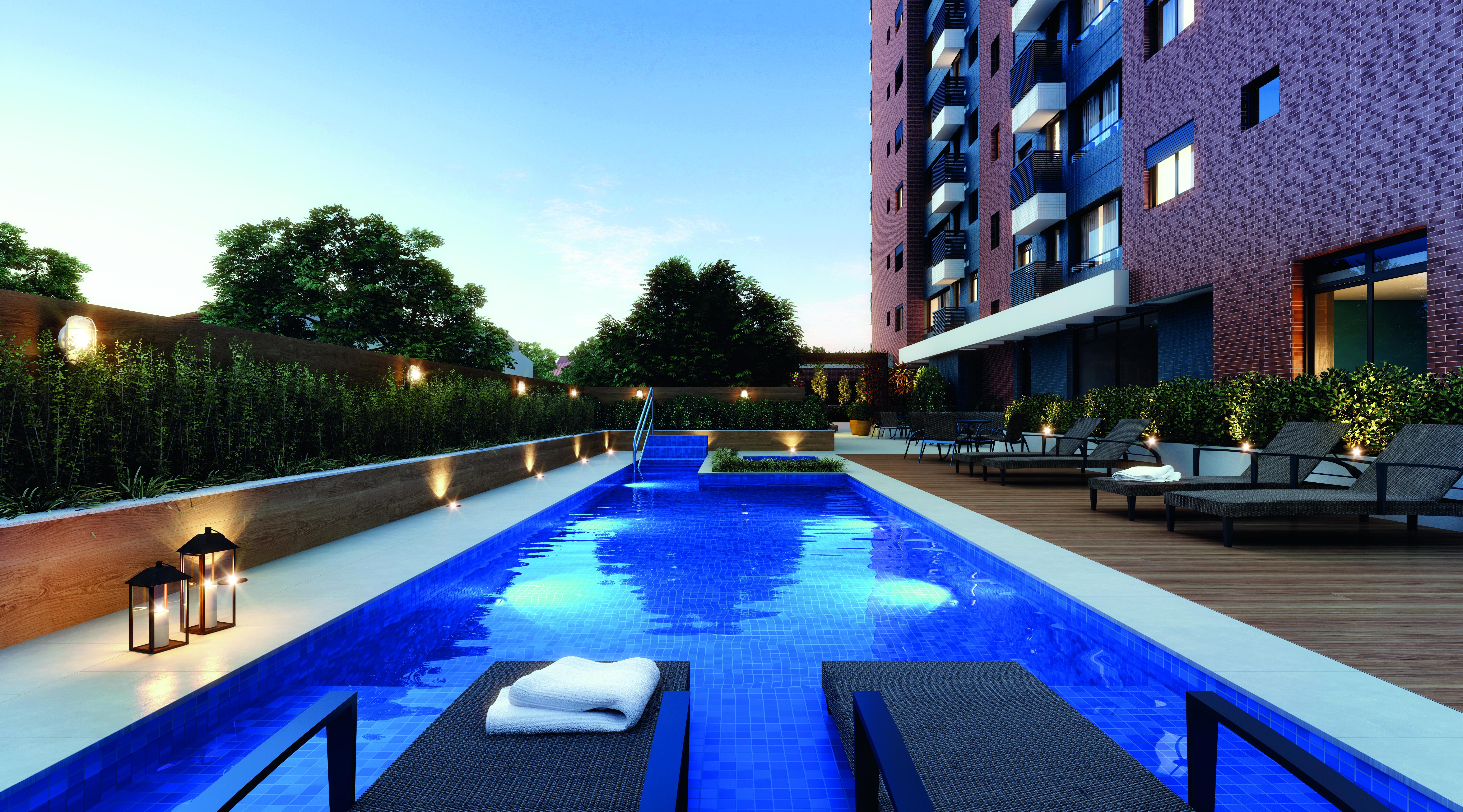 ângulo da área condominial do empreendimento Leeds da Colla Construções (visão da piscina para o prédio) - lazer